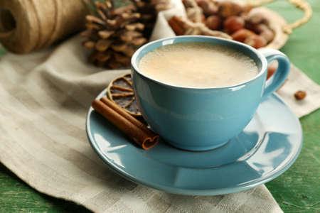 Cup of coffee on napkin near meta tray