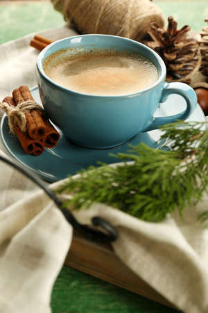 Cup of coffee on napkin on wooden tray Stock Photo