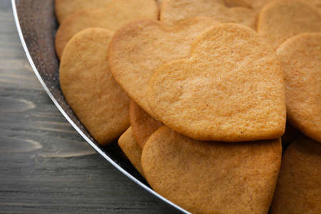 Heart shaped biscuits in baking tray, closeup Stock Photo