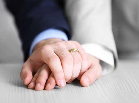 Two  homosexuals wearing wedding rings Foto de archivo