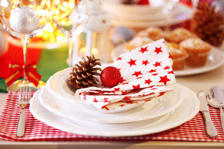Christmas table setting with holiday decorations Stock Photo
