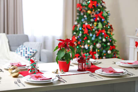 Christmas table setting on light room background 스톡 콘텐츠