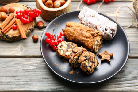 Chocolate salami in a plate on a wooden background Stock Photo