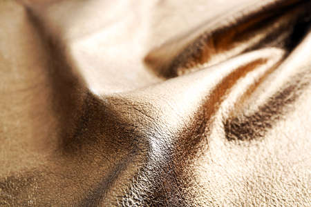 Dark brown shiny leather texture close up