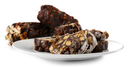 Chocolate salami in a plate, isolated on white