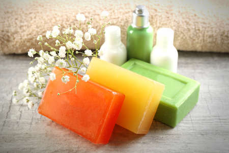 Soap set on a wooden background, close up Stock Photo
