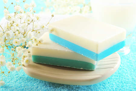 Soap set on a towel background, close up