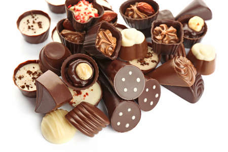 Assorted chocolate candies on white background