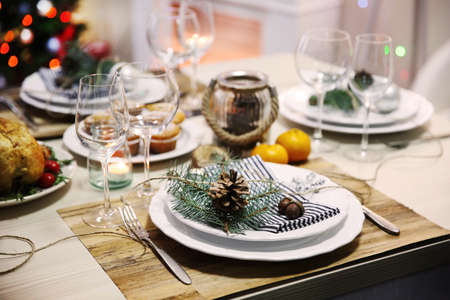 Table setting for Christmas dinner at home Stock Photo