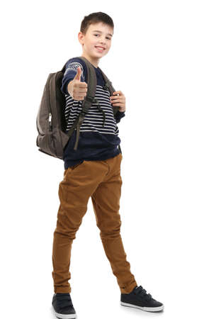 Happy cute little boy with grey backpack, isolated on white