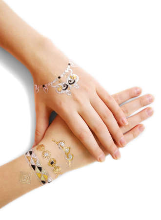 Silver and golden flash tattoo on female hands over white background Stock Photo