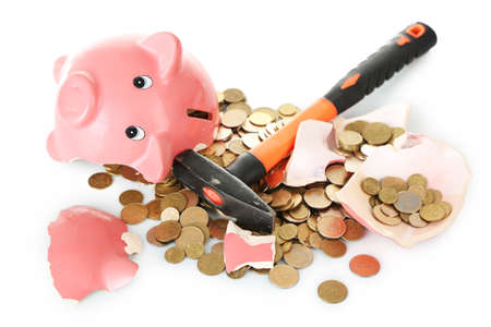 Piggy bank is broken by hammer isolated on white background Stock Photo