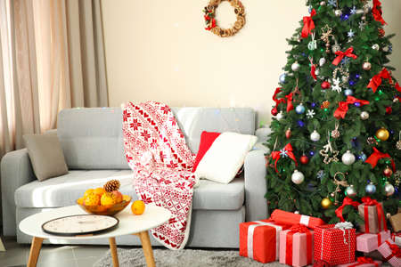 Christmas interior with fir tree and gifts