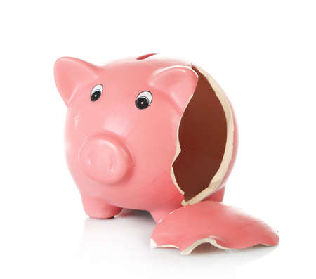 Broken piggy bank isolated on white background