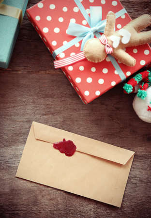 Christmas concept. Envelop with Christmas decorations on wooden background Stock Photo