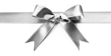 Silver silk ribbon with beautiful bow isolated on white background Stock Photo