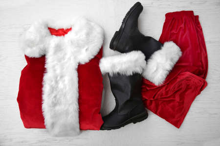Santa Claus costume on white wooden background, close up