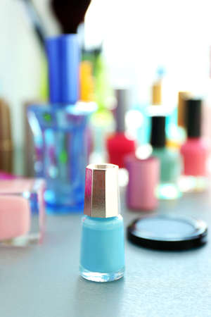 Nail polish with makeup cosmetics on a table Stock Photo