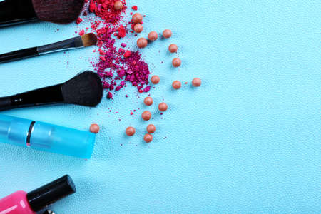 Makeup tools and cosmetics on blue background Stock Photo