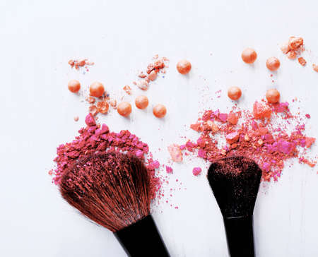 Makeup tools with powder on white background