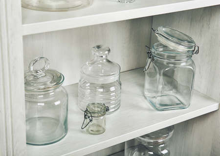 Glass dishes on shelf in the kitchen