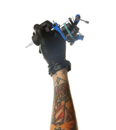 Mans hand holding tattoo machine on white background