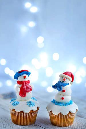 Christmas cupcakes with lights on background Reklamní fotografie