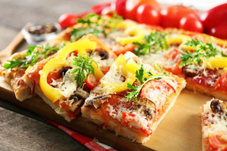 Pieces of delicious pizza on the table, close-up Stock Photo