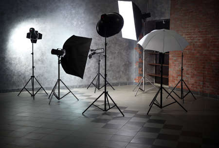 Empty photo studio with lighting equipment Stok Fotoğraf - 95393613