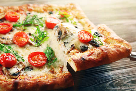 Piece of freshly homemade pizza closeup Stock Photo