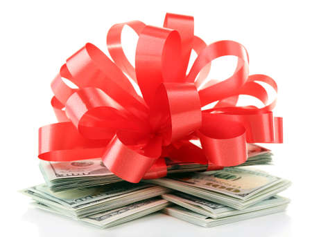 Dollars and big red bow isolated on white Stock Photo