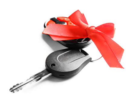 Gift car keys with red bow, isolated on white Stock Photo