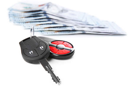 Car keys with dollar banknotes on white background Stock Photo