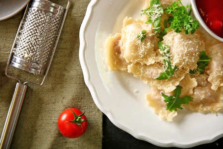 Cooked ravioli with tomato sauce on plat Stock Photo