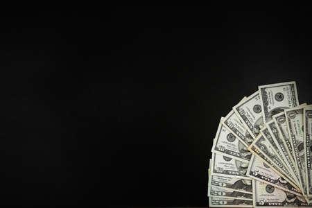 Dollar banknotes on black background