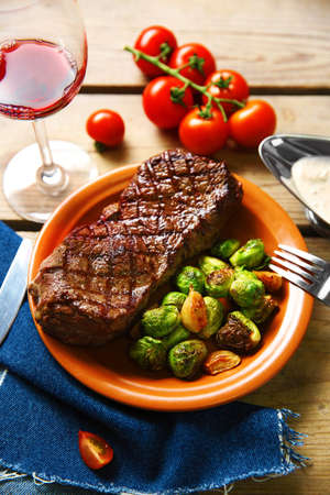 Grilled steak with vegetables, closeup