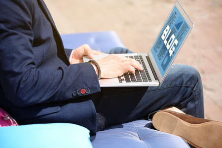 Young man working with laptop, outdoors Stock Photo