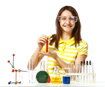 Beautiful girl with chemical flasks and test-tubes isolated on white