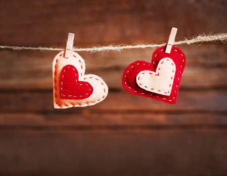 Valentine concept. Two love hearts hanging on clothesline Stock Photo