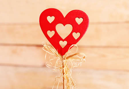 Valentine concept. Red heart on wooden background Stock Photo