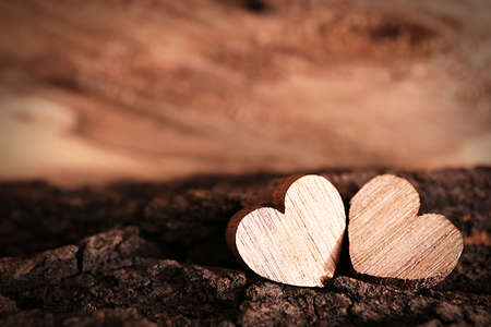 Valentine concept. Two love hearts on wooden background Stock Photo