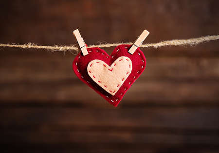 Valentine concept. Love heart hanging on clothesline Stock Photo