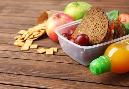 Kid school lunch on wooden background