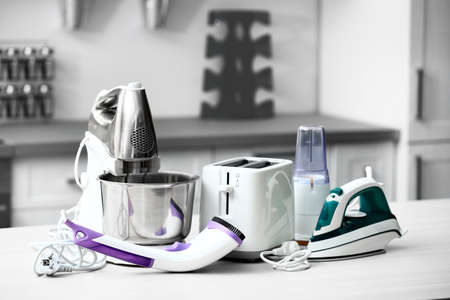 Household and kitchen appliances on the table in kitchen Stockfoto