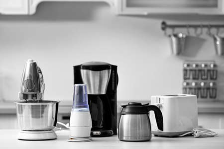 Household and kitchen appliances on the table in kitchen Foto de archivo