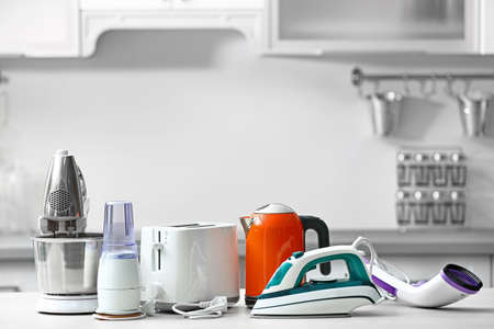 Household and kitchen appliances on the table in kitchen Imagens