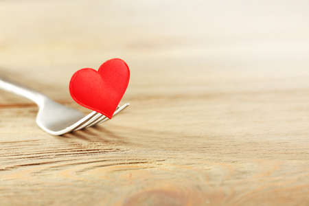 Concept image for Valentines Day dining, on wooden background