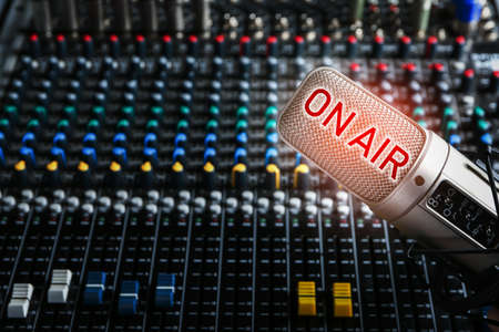 Microphone and mixer for live radio broadcast at modern studio Stok Fotoğraf