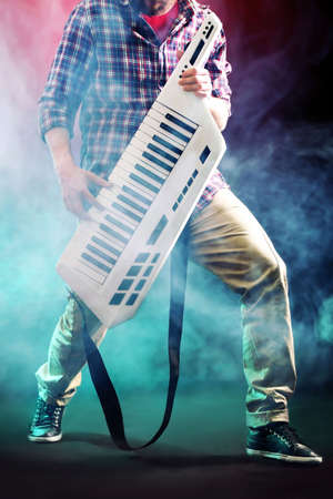 Male hands with synthesizer in smoke Stock Photo