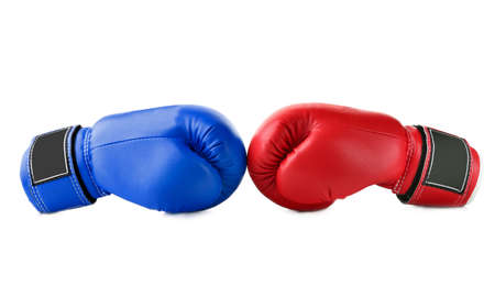 Red and blue boxing gloves on white background. Concept of political confrontation between American major parties - Democratic and Republican
